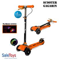 Детский трёхколёсный самокат SCOOTER MAXI CITY GAGARIN со светящимися колёсами и ручным тормозом orange